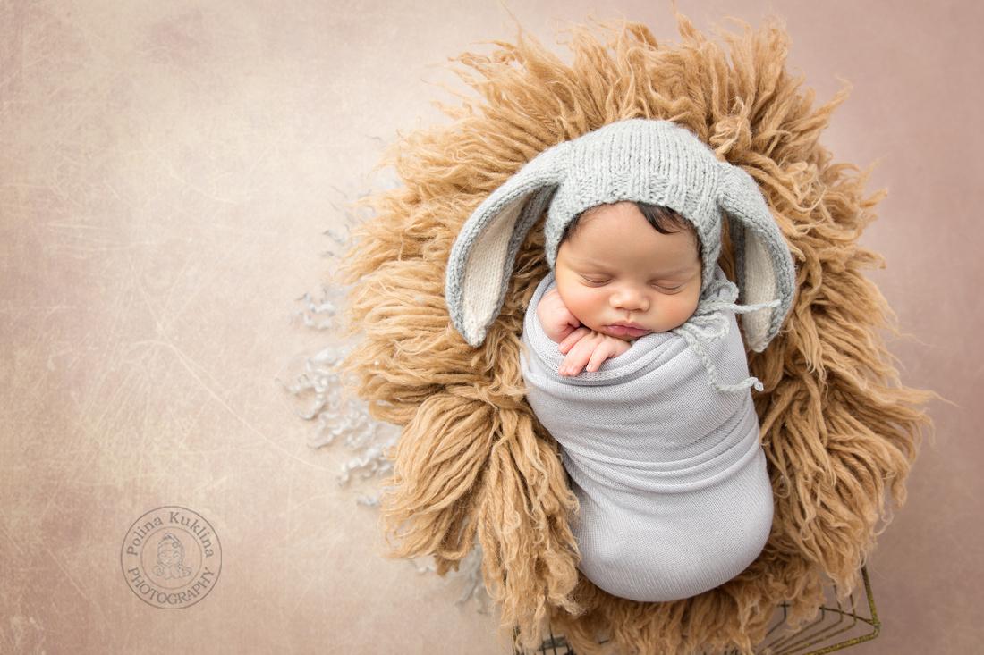 newborn baby-boy in a bunny bonnet