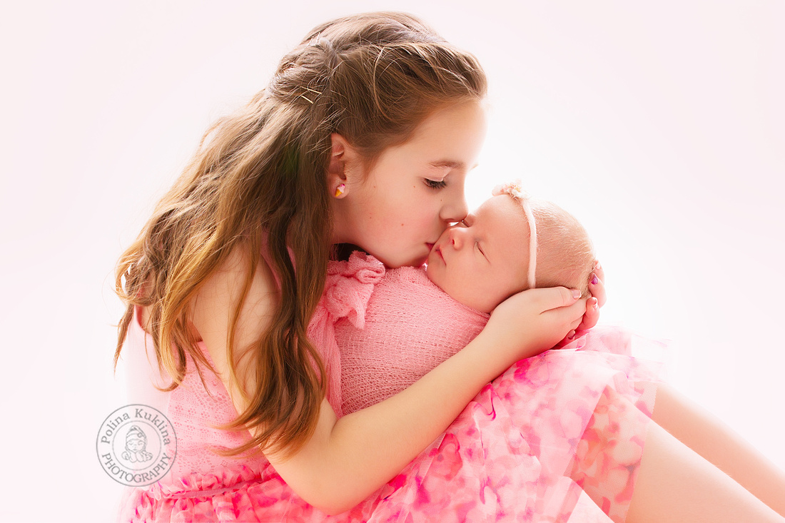 Two sisters. newborn and 5 year old