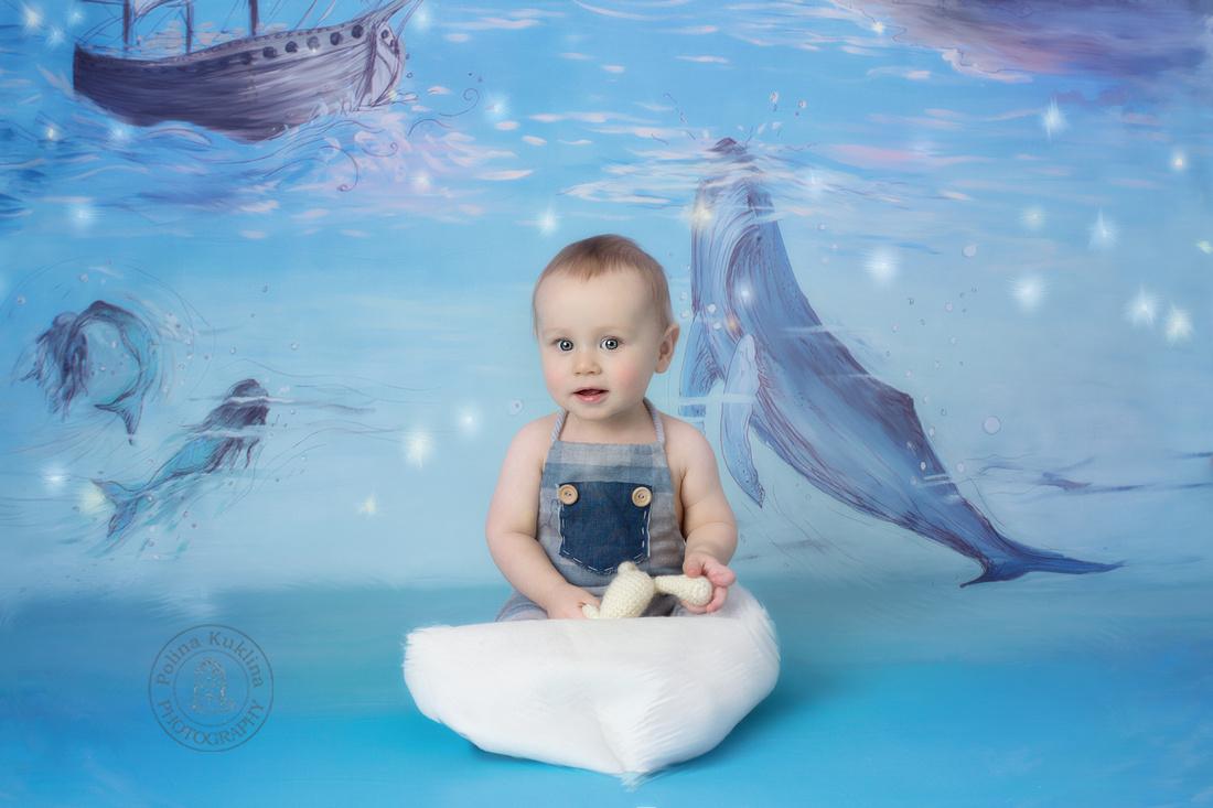 Milestone portrait of 8-months old baby boy