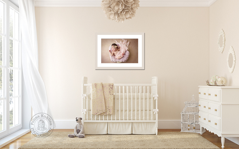 Fine art newborn portrait on the wall